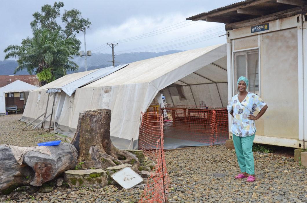 Nurse outside of tent