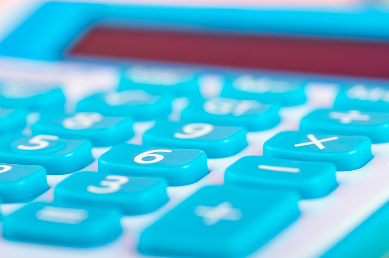 close-up and selective focus shot, calculator on wooden desk