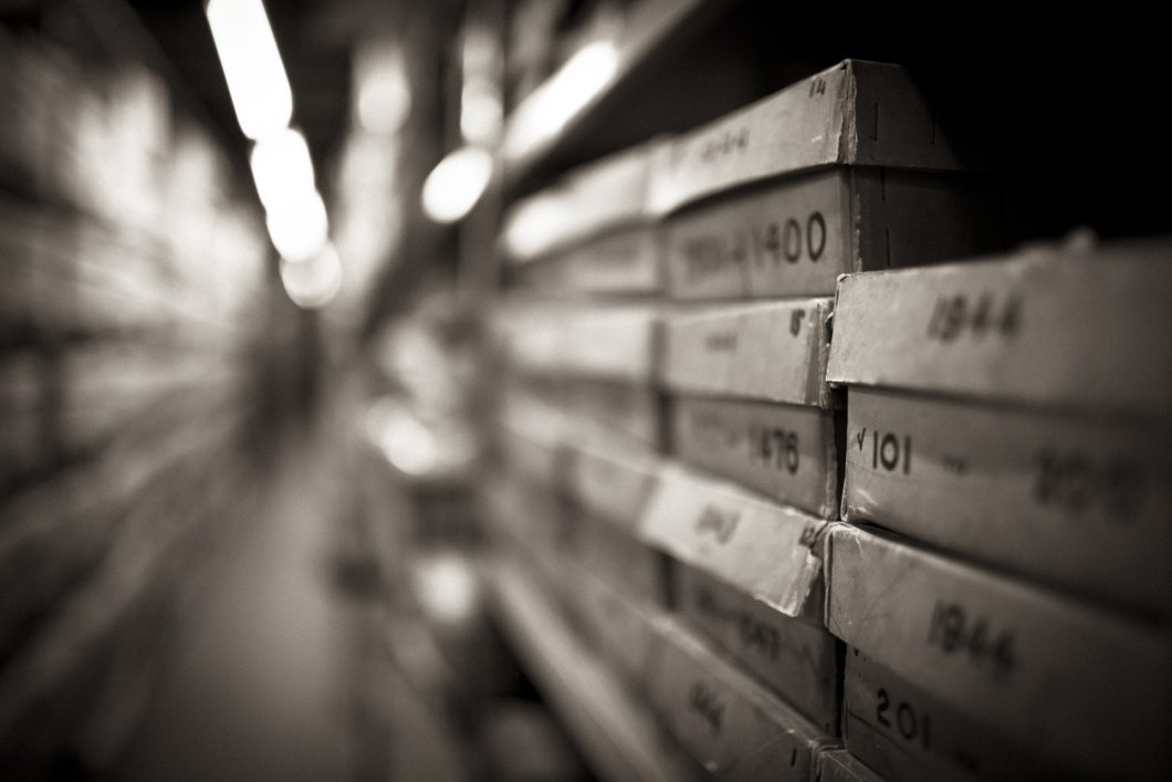 Close up of white archive boxes on shelves